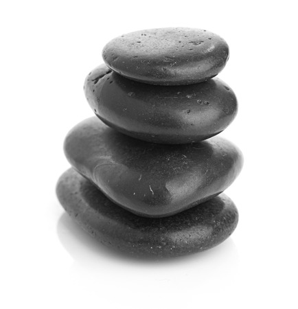 Growing piled up pebbles on a white background photo