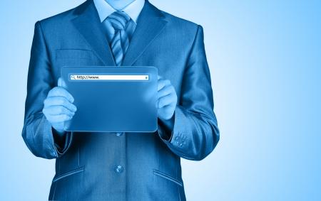 Businessman pushing virtual search bar photo
