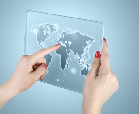 woman hand touch world map and connection photo