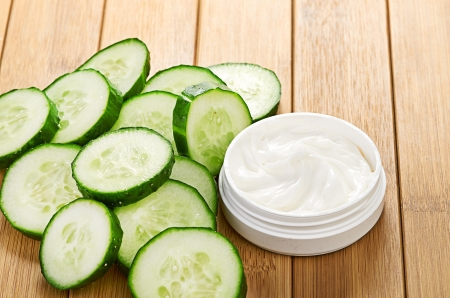 face mask with cucumber slices photo
