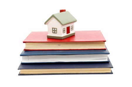 little house and books isolated on white background photo