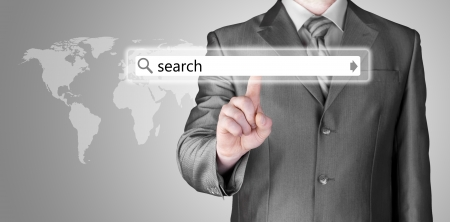 web address: Businessman pushing virtual search bar