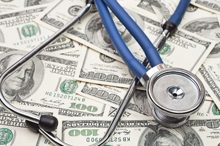 heap of dollars with stethoscope photo