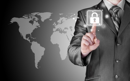 lock  futuristic: Businessman selecting a white padlock with world map on the background Stock Photo