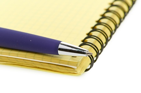 notepad and pen isolated on white background photo