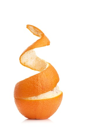 orange with peeled spiral skin isolated on white background photo