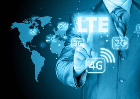activate: businessman is pushing his finger on lte button