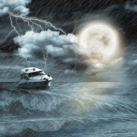 Boat in storm  evening on ocean and the moon photo