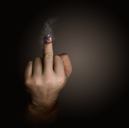 provocation: stop smoking concept. cigarette like a middle finger Stock Photo