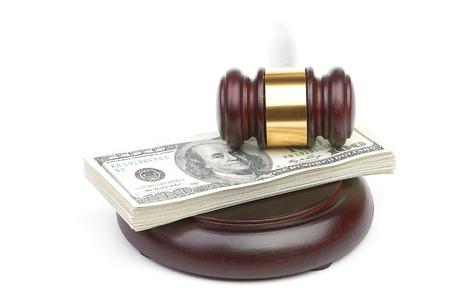 Law gavel on a stack of American money. Stock Photo