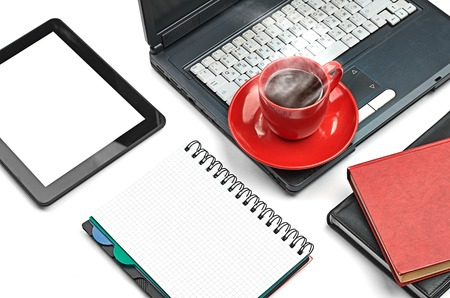 Laptop and office supplies on white photo