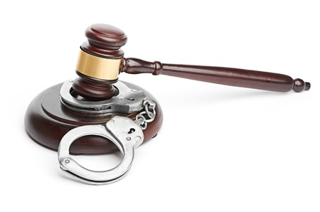 handcuffs and gavel Stock Photo - 26310479