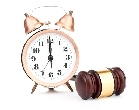 Gavel and old clock Stock Photo