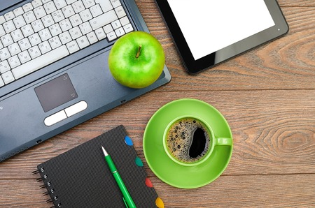 green apple on worplace photo