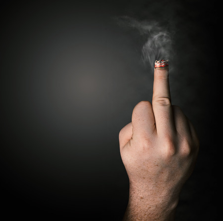 stop smoking concept. cigarette like a middle finger photo