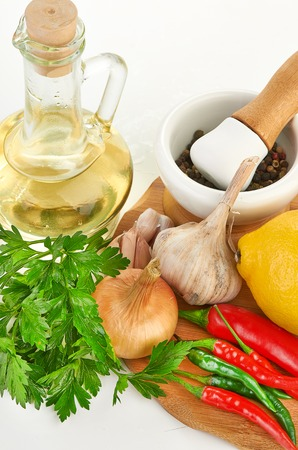 Fresh cooking ingredients with olive oil photo
