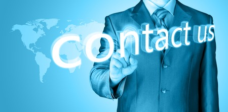 sent: businessman hand pushing contact us button on a touch screen interface Stock Photo