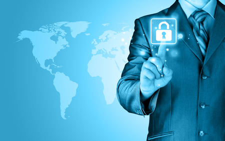 Businessman selecting a white padlock with world map on the background photo