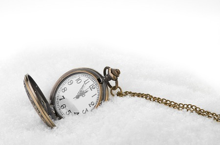 New Year's backgrounds .pocket watch in the snow photo
