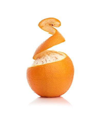 orange peel: orange with peeled spiral skin isolated on white background