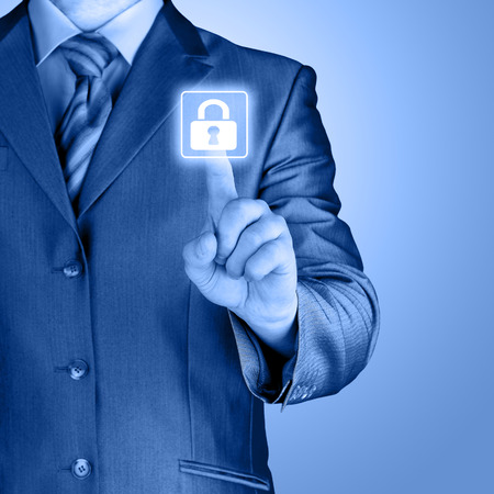 Businessman pushing virtual security button on digital background photo