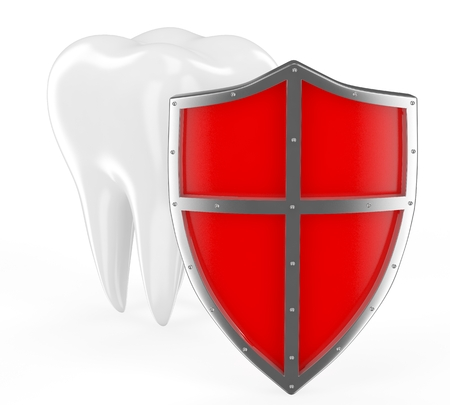 Tooth with metal shield on white background (Protection Concept) photo