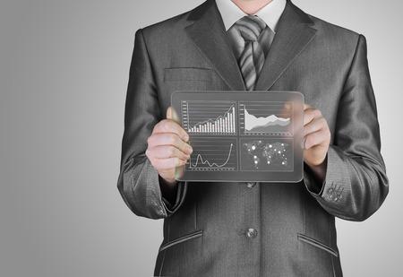 businessman with financial symbols photo