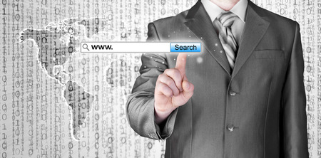 Businessman pushing virtual search bar photo