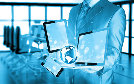 business communication: Technology in the hands of businessmen Stock Photo