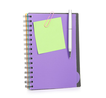 Notebook and pen isolated on white photo