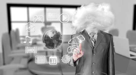 Young businessman with head in the clouds photo