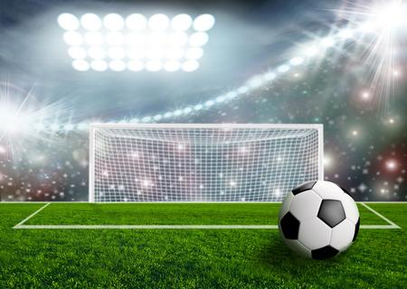 stadium lights: Soccer ball on green stadium arena