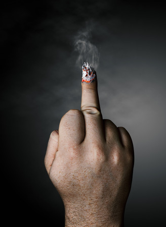 stop smoking concept  cigarette like a middle finger photo