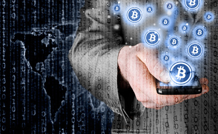 e cash: Hand with mobile smart phone and bitcoin symbol Stock Photo