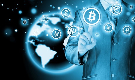net trade: Choosing bitcoins, businessman pressing touch screen button  Stock Photo