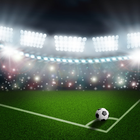 stadium lights: soccer ball on the green field corner