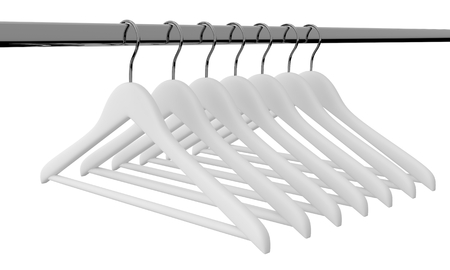 cloakroom: White clothes hangers isolated