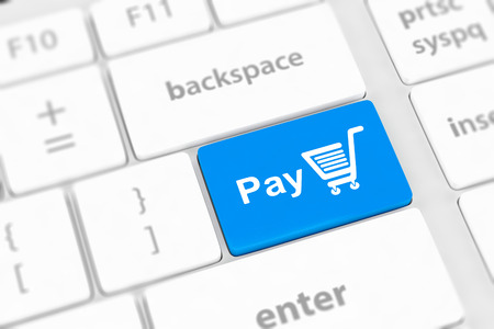 Pay key with shopping cart icon on a white keyboard photo