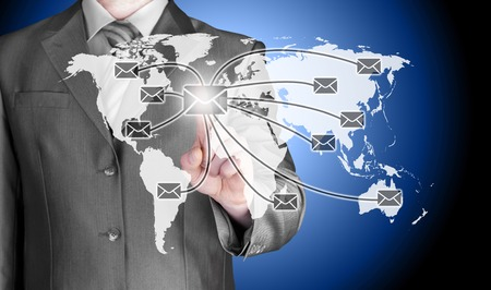 distribute: business man distribute digital mail Stock Photo