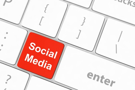 Social media concept on keyboard background photo