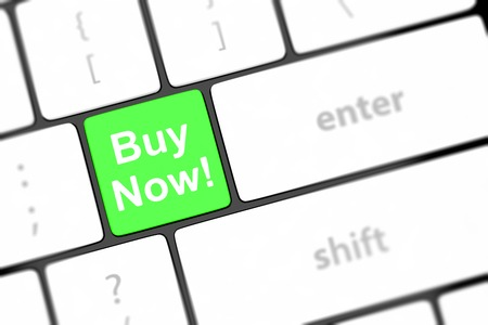 Buy now key on a white keyboard photo