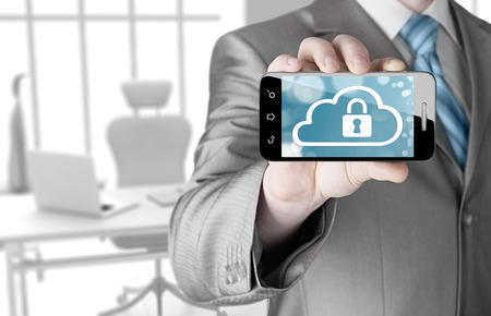 Man holds smart phone with cloud security concept photo
