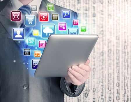 dial pad: Business man use tablet pc with colorful application icons Stock Photo