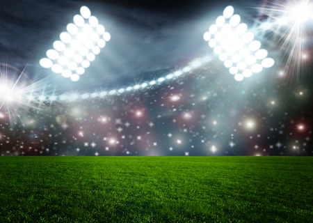 soccer field: Soccer ball on green stadium arena