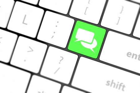 Social media key with two speech bubble sign on the keyboard photo