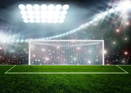 football field: Soccer ball on green stadium arena