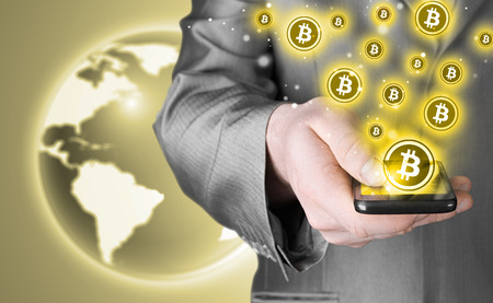 e banking: Hand with mobile smart phone and bitcoin symbol Stock Photo