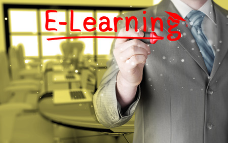 business man writing e-learning concept photo