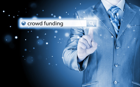 crowd sourcing: Businessman and crowd funding in search bar Stock Photo
