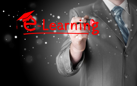 business man writing e-learning concept Stock Photo